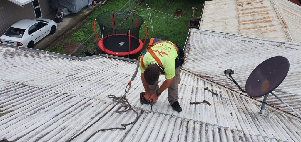gutter guard guys repairing roof, drilling into roof